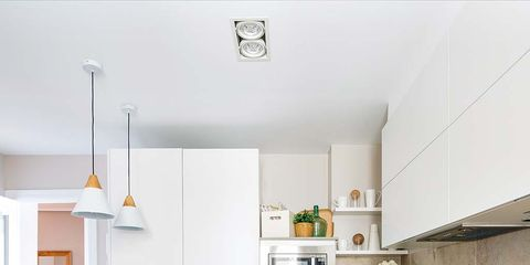 Countertop, Room, Kitchen, White, Furniture, Property, Cabinetry, Interior design, Yellow, Floor,