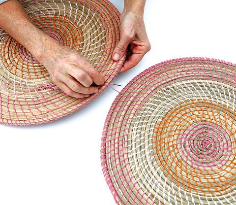 People in nature, Colorfulness, Circle, Creative arts, Basket, Craft, Wicker, Thread, Woven fabric, Flesh,