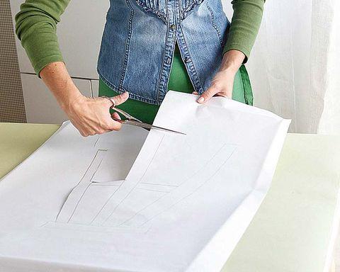 Sleeve, Textile, Stationery, Denim, Paper product, Paper, Pocket, Design, Fashion design, Pattern,