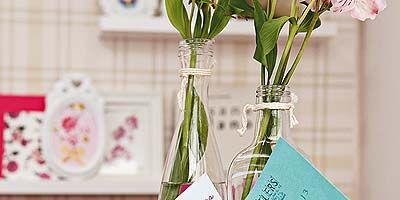 Pink, Glass, Bouquet, Petal, Interior design, Artifact, Centrepiece, Cut flowers, Vase, Teal,