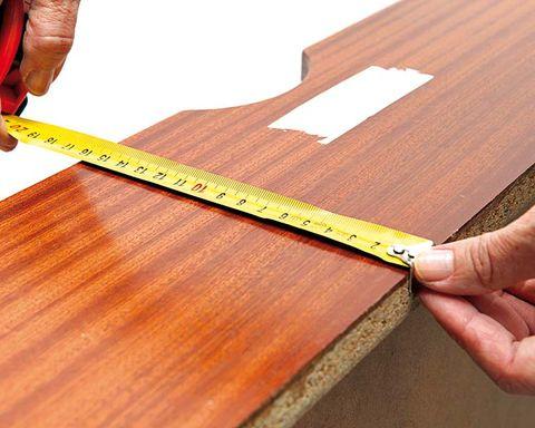 Wood, Finger, Hardwood, Wood stain, Tan, Parallel, Tool, Plywood, Varnish, Tape measure,