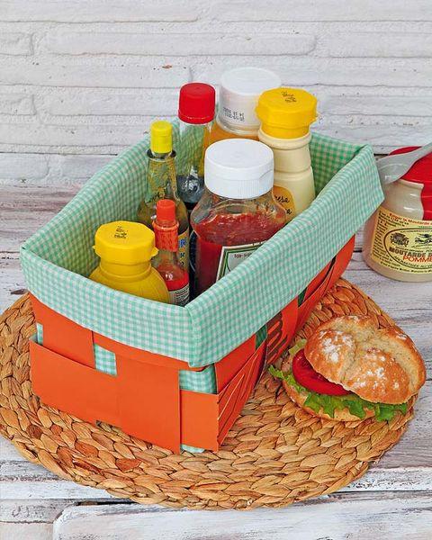 Basket, Storage basket, Wicker, Home accessories, Orange, Bottle, Plastic bottle, Picnic basket, Peach, Food storage,