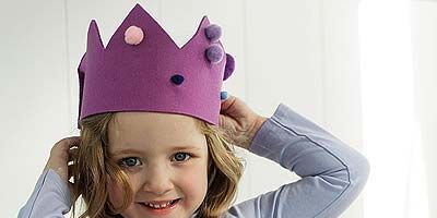 Sleeve, Happy, Baby & toddler clothing, Headgear, Costume accessory, Purple, Hair accessory, Violet, Lavender, Gesture,