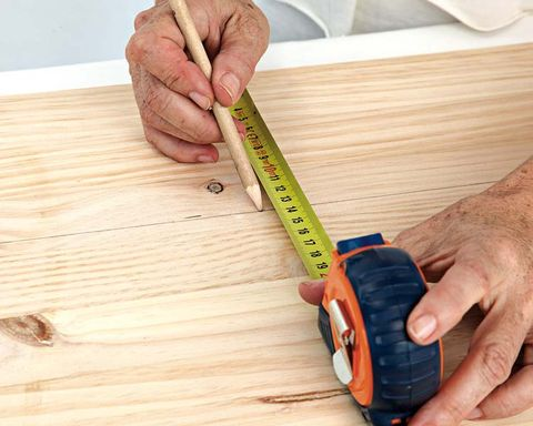 Wood, Finger, Hand, Wrist, Hardwood, Wood stain, Nail, Thumb, Auto part, Rim,