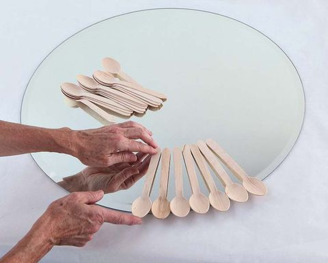 Finger, Wrist, Gesture, Thumb, Natural material, Kitchen utensil, Circle, Chemical compound, Cutlery, Paper,
