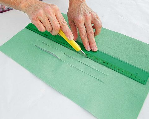 Finger, Green, Wrist, Nail, Stationery, Office supplies, Paper product, Thumb, Paper, Document,