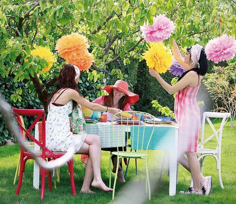 Leg, Dress, Outdoor furniture, Pink, Furniture, Petal, Summer, Sitting, People in nature, Outdoor table,