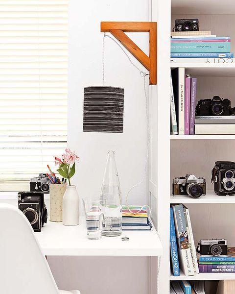 Room, Shelving, Shelf, Furniture, Interior design, Bottle, Wall, Glass bottle, Window covering, Window blind,