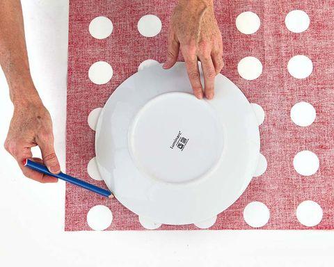 Dishware, Pattern, Serveware, Kitchen utensil, Wrist, Circle, Nail, Plate, Polka dot, Porcelain,
