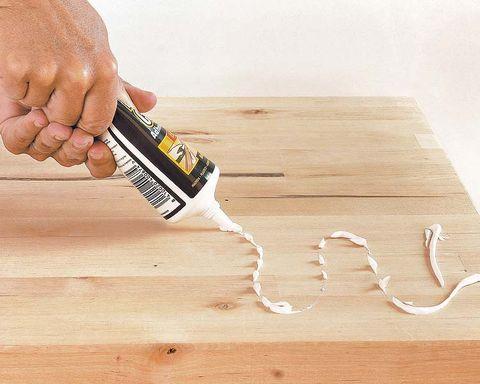 Wood, Finger, Hardwood, Flooring, Wrist, Floor, Wood flooring, Wood stain, Laminate flooring, Nail,