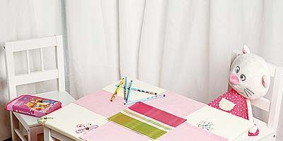 Room, Textile, Table, Furniture, Interior design, Toy, Stuffed toy, Linens, Home accessories, Desk,
