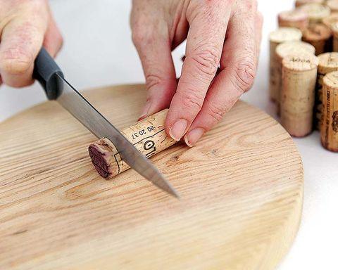 Wood, Finger, Cork, Hardwood, Wrist, Wood stain, Thumb, Nail, Kitchen utensil, Plywood,