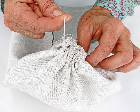 Finger, Skin, Textile, Wrist, Nail, Thumb, Thread, Wrinkle, Craft, Gesture,