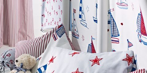 Textile, Stuffed toy, Carmine, Pattern, Toy, World, Teddy bear, Home accessories, Cushion, Symbol,