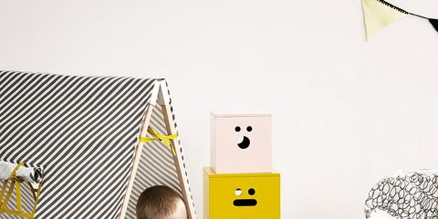 Room, Learning, Chest of drawers, Reading, Stuffed toy, Creative arts, Drawer, Toy, Paper product, Cardboard,