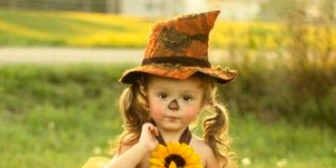 Clothing, Nose, Hat, Dress, Child, People in nature, Costume, Headgear, Fashion accessory, Costume accessory,