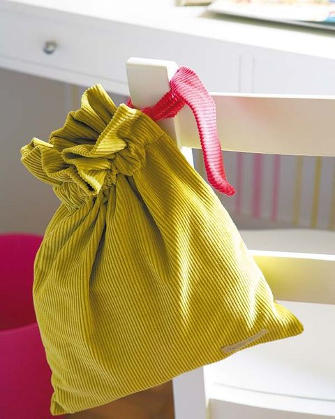 Yellow, Textile, Bag, Interior design, Shoulder bag, Home accessories, Cup, Mug, Coffee cup, Linens,