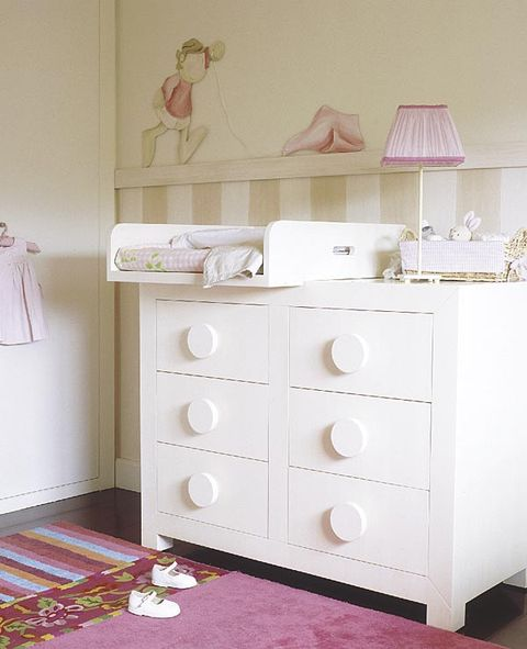 Room, Drawer, Interior design, Chest of drawers, Floor, White, Pink, Cabinetry, Home, Flooring,