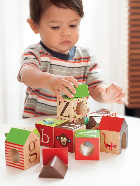 Toy, Child, Baby & toddler clothing, Toy block, Cardboard, Paper product, Baby toys, Wooden block, Toddler, Baby playing with toys,