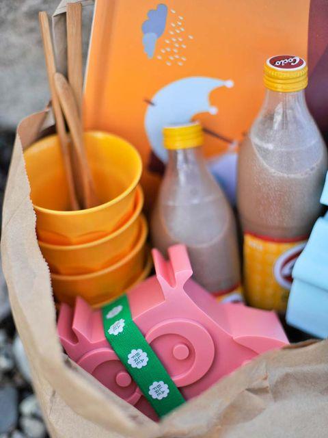 Bottle, Peach, Orange, Liquid, Drink, Plastic bottle, Drinkware, Plastic, Bottle cap, Carbonated soft drinks,