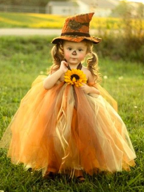 Clothing, Nose, Hat, Dress, Child, Fashion accessory, People in nature, Headgear, Costume accessory, Costume,