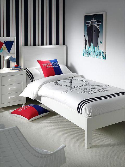 Blue, Room, Interior design, Bed, Bedding, Bedroom, Textile, Bed sheet, Floor, Wall,