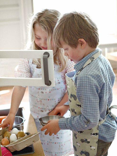 Pattern, Blond, Eyelash, Apron, Countertop, Cooking, Plaid, Kitchen appliance, Kitchen utensil, Food group,