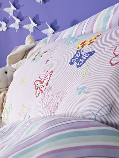 Textile, Pink, Linens, Bedding, Bed sheet, Purple, Stuffed toy, Bedroom, Aqua, Bed,