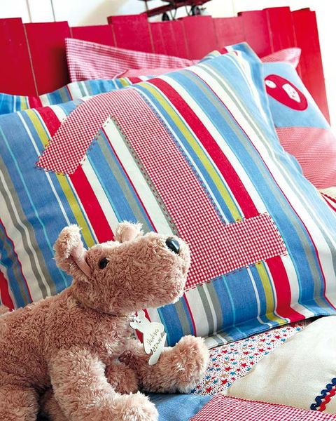 Stuffed toy, Blue, Toy, Textile, Linens, Room, Interior design, Plush, Teddy bear, Clothes hanger,