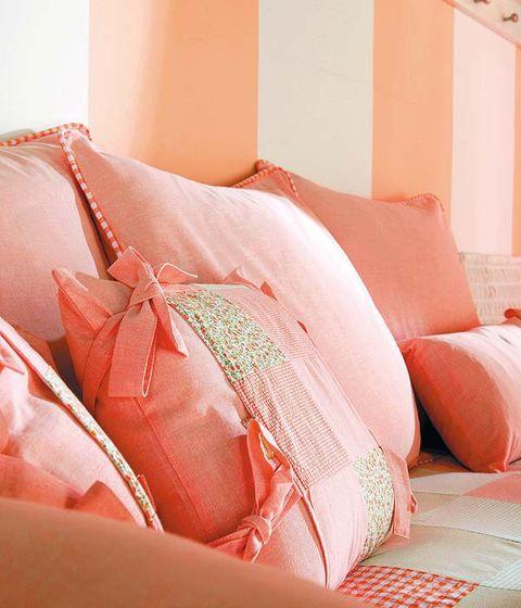 Textile, Orange, Peach, Interior design, Room, Pink, Carmine, Tan, Pillow, Bedding,