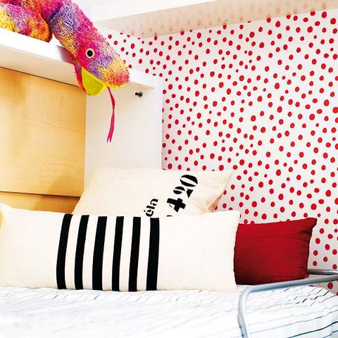 Room, Interior design, Textile, Bedding, Linens, Bedroom, Orange, Cushion, Bed sheet, Pillow,