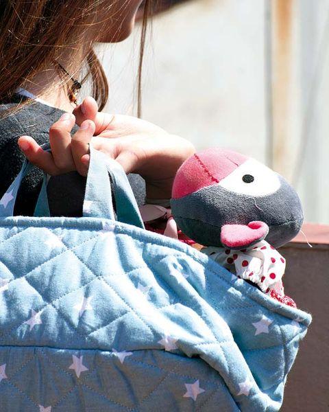 Human, Toy, Textile, Stuffed toy, Plush, Pattern, Nail, Baby toys, Bag, Long hair,