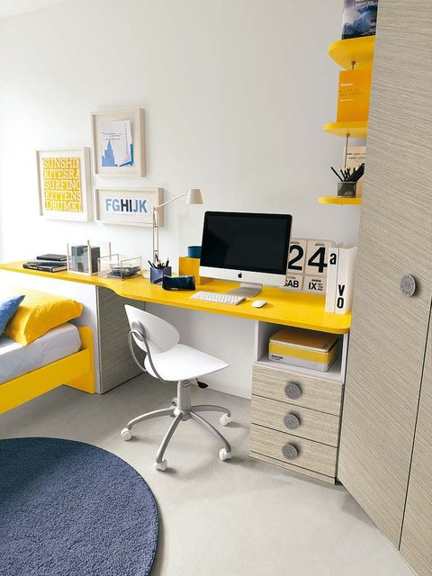 Room, Yellow, Interior design, Electronic device, Table, Display device, Furniture, Wall, Computer desk, Floor,