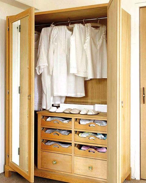 Wood, Room, Clothes hanger, Floor, Hardwood, Shelving, Closet, Wardrobe, Fixture, Shelf,