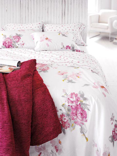 Bed, Room, Interior design, Bedding, Bedroom, Bed sheet, Textile, Photograph, Red, Furniture,