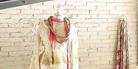 Mannequin, Linens, Costume design, Fashion design, Pattern, Bed sheet, Bedroom, Bedding, Bed, Wood flooring,
