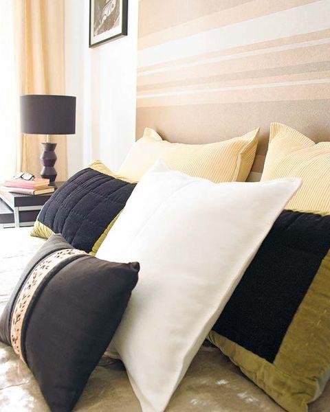 Room, Interior design, Textile, Bedding, Linens, Pillow, Cushion, Wall, Throw pillow, Home accessories,