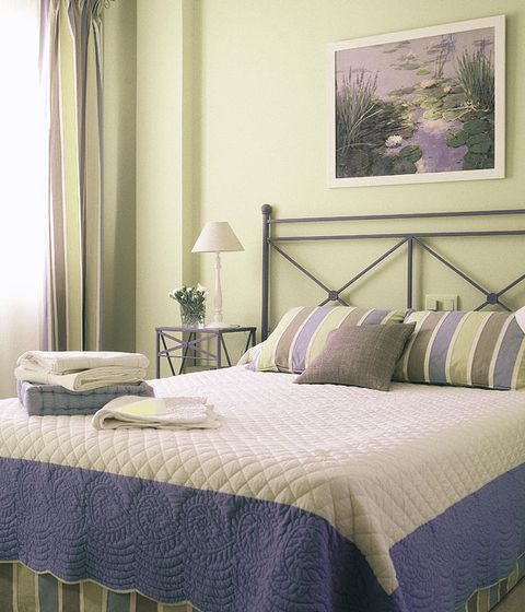 Green, Room, Interior design, Bedding, Bed, Property, Bedroom, Textile, Bed sheet, Wall,