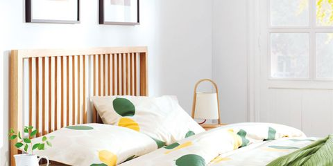 Green, Room, Yellow, Interior design, Bed, Wood, Bedding, Textile, Wall, Furniture,