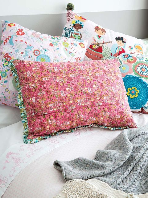 Textile, Pattern, Pink, Cushion, Linens, Bedding, Home accessories, Pillow, Teal, Creative arts,