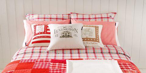 Room, Pattern, Green, Bed, Interior design, Textile, Red, Bedding, Linens, Bedroom,