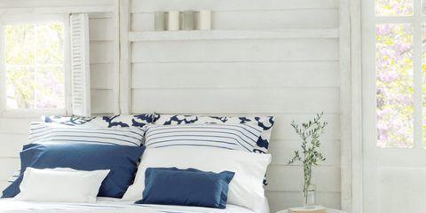 Blue, Room, Bed, Interior design, Bedding, Property, Wall, Textile, Floor, Bedroom,