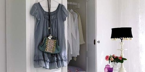 Room, Clothes hanger, Interior design, Cabinetry, Chest of drawers, Drawer, Grey, Home, Interior design, Cupboard,
