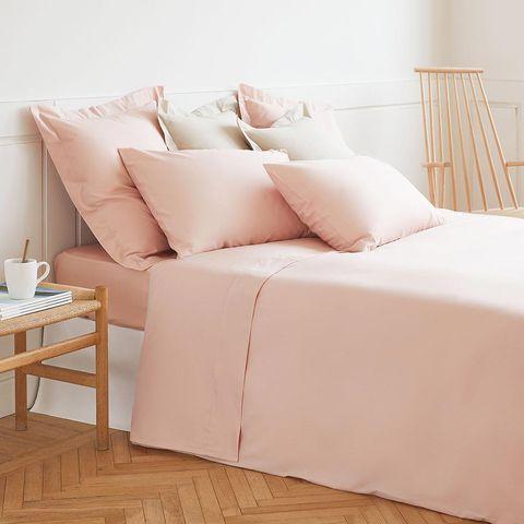 Furniture, Bedding, Bed sheet, Pink, Room, Textile, Slipcover, Floor, Linens, Interior design,