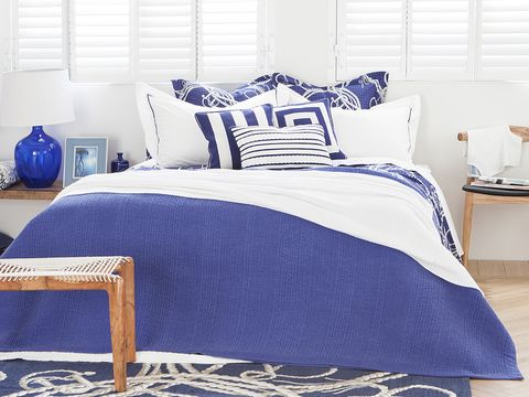 Blue, Room, Bed, Bedding, Interior design, Textile, Bedroom, Bed sheet, Furniture, Wall,
