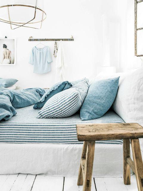 Furniture, Blue, Room, Bedroom, Bed sheet, Bed, Turquoise, Table, Bedding, Interior design,