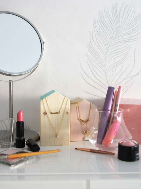 Lipstick, Feather, Mirror, Still life photography, Household supply, Cosmetics, Peach, Circle, Natural material, Lamp,