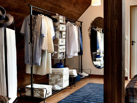 Room, Textile, Flooring, Floor, Clothes hanger, Interior design, Tartan, Plaid, Door, Closet,