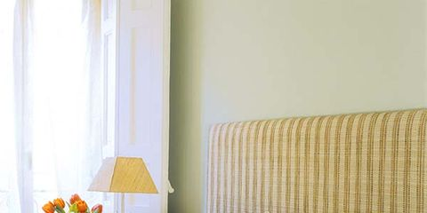 Yellow, Room, Interior design, Textile, Bedding, Wall, Linens, Bedroom, Bed sheet, Bed,