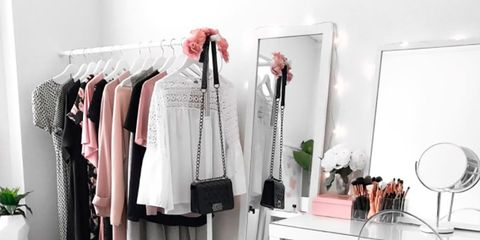 Room, Clothes hanger, Furniture, Pink, Floor, Interior design, Closet, Table, Chest of drawers, Flooring,